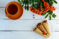 Homemade honey wafers rolled into a cone, filled with caramel (condensed milk), Royalty Free Stock Photos