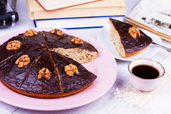 Homemade honey walnut and chocolate pie, cup of coffee. Stock Images