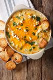 Homemade hot buffalo chicken dip with crostini close up in bakin Stock Photography