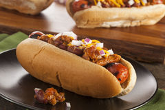 Homemade Hot Chili Dog with Cheddar Cheese. And Onions stock photos