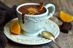 Homemade hot chocolate with orange and cinnamon. Royalty Free Stock Photography