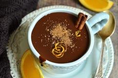 Homemade hot chocolate with orange and cinnamon. Royalty Free Stock Photos