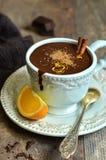 Homemade hot chocolate with orange and cinnamon. Stock Image