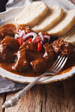 Homemade hot Czech goulash with knodel close-up. vertical Royalty Free Stock Images