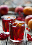 Homemade Hot Delicious Red Sangria with Berries, Oranges, Spices and Apples. Mulled wine or punch. Royalty Free Stock Photos