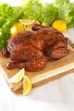 Homemade hot smoked whole chicken Stock Photo