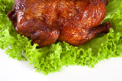 Homemade hot smoked whole chicken on leaf Stock Images