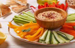 Homemade hummus with assorted fresh vegetables and pita bread. Royalty Free Stock Photo