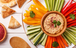 Homemade hummus with assorted fresh vegetables and pita bread. Stock Photo