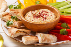 Homemade hummus with assorted fresh vegetables and pita bread. Healthy homemade hummus with assorted fresh vegetables and pita bread Royalty Free Stock Image