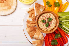Homemade hummus with assorted fresh vegetables and pita bread. Healthy homemade hummus with assorted fresh vegetables and pita bread Royalty Free Stock Images