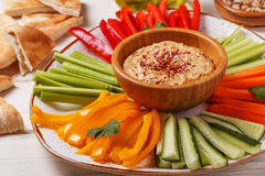 Homemade hummus with assorted fresh vegetables and pita bread. Healthy homemade hummus with assorted fresh vegetables and pita bread Stock Photography