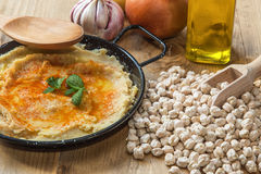 Homemade hummus with garlic and onions paprika Royalty Free Stock Photo