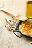 Homemade hummus with garlic and onions paprika Royalty Free Stock Images