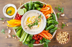 Homemade hummus. With olive oil and fresh vegetables stock photo