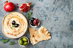 Homemade hummus with paprika, olive oil. Middle Eastern traditional and authentic arab cuisine. Meze party food. Top view, flat lay, overhead royalty free stock image