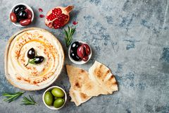 Homemade hummus with paprika, olive oil. Middle Eastern traditional and authentic arab cuisine. Meze party food. Top view, flat lay, overhead stock image