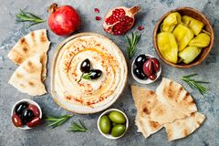 Middle Eastern traditional dinner. Authentic arab cuisine. Meze party food. Top view, flat lay, overhead. Homemade hummus with paprika, olive oil. Middle stock images