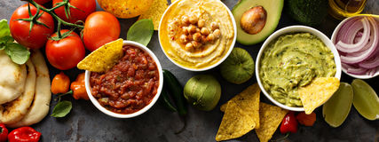 Homemade hummus, salsa and guacamole with corn chips Royalty Free Stock Photos