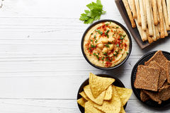Homemade hummus and snacks Stock Images