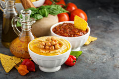 Homemade hummus and tomato salsa in white bowls Stock Photos
