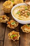Homemade hummus in tortilla bowls Stock Photos