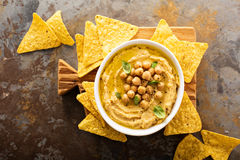 Homemade hummus with tortilla chips. Overhead shot Stock Photo