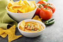 Homemade hummus in white bowl with corn chips. Homemade hummus in white bowl with paprika and corn chips Stock Images