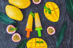 Homemade ice cream from mango and passion fruit. Popsicle stock photography