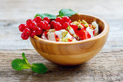 Homemade ice cream with pistachios and red currant. Royalty Free Stock Image