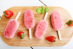 Homemade ice cream pops with fresh berries. Stock Images