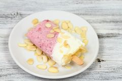 Homemade ice lolly from strawberries and cottage cheese with almond pieces Stock Photography
