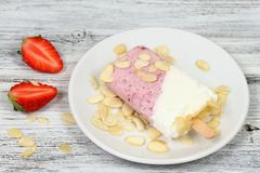 Homemade ice lolly from strawberries and cottage cheese with almond pieces Royalty Free Stock Photography