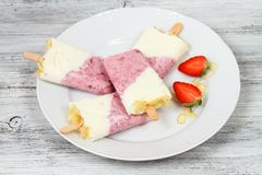 Homemade ice lolly from strawberries and cottage cheese with almond pieces Royalty Free Stock Image
