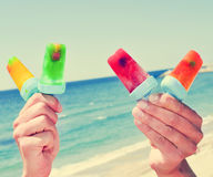Homemade ice pops on the beach, with a filter effect Stock Photos