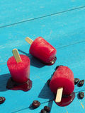 Homemade ice pops on garden table Royalty Free Stock Photos