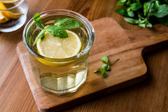 Homemade ice tea with lemon and mint leaves. Royalty Free Stock Images