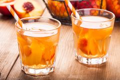 Homemade ice tea with peach slices in glasses with straws Royalty Free Stock Photo