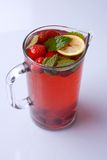 Homemade iced tea. With strawberries, lemon and mint Stock Images
