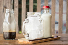 Homemade iced coffee ingredient on wooden table Royalty Free Stock Images