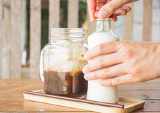 Homemade iced coffee ingredient on wooden table Royalty Free Stock Image