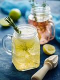 Homemade Iced fizzy Sparkling lemonade with lemon, rosemary and. Thyme in Mason jar royalty free stock images