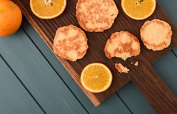 Homemade imperfect cookies and orange slices on dark oak board t. Op view copyspace royalty free stock photography