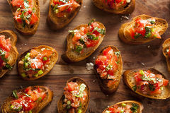 Homemade Italian Bruschetta Appetizer. With Basil and Tomatoes Stock Photos
