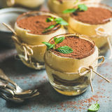 Homemade Italian dessert Tiramisu served in individual glasses, square crop Stock Photography