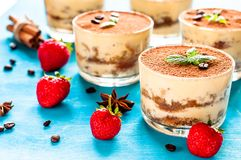 Homemade italian dessert tiramisu with strawberries and mint in glass Royalty Free Stock Images