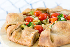 Homemade italian galette with cherry tomatoes, broccoli and cheese Royalty Free Stock Images