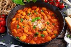 Homemade Italian Gnocchi with marinara sauce, cheese in iron pan Royalty Free Stock Photos