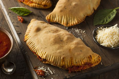 Homemade Italian Meat and Cheese Calzones Royalty Free Stock Photos