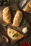 Homemade Italian Meat and Cheese Calzones Stock Photography